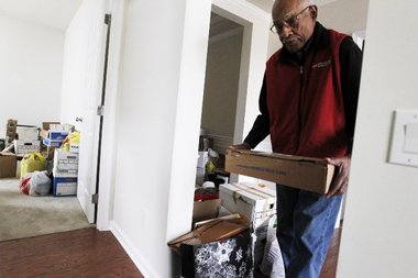 James Clark works to unpack boxes after his recent move to Howell from Short Hills. Robert Sciarrino/NJ Advance Media