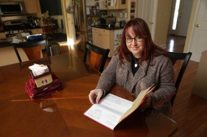 Nicole Levy Fiore, pictured in her Ledgewood home, is fighting two insurance companies, the state and the Jersey City Board of Education to solve a huge health insurance mix-up. (John O'Boyle/NJ Advance Media