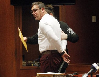 Daryl Turner is placed in handcuffs after his January 2014 sentencing. Ed Murray/The Star-Ledge