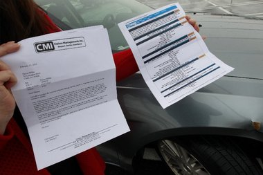 Dayna Miller holds the accident report and claim denial letter she received from Sam's Club after she said her car was damaged by runaway shopping carts. Robert Sciarrino/NJ Advance Media