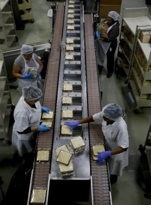 Freshly baked matzos from are packaged during the final steps on the matzo production line at the Manischewitz manufacturing facility in Newark on Feb. 4, 2014. Under strict rabbinical supervision at all times and in all stages of production, over 1 million sheets of matzo are produced daily during the height of the Passover season. Jeff Zelevansky/Getty Images