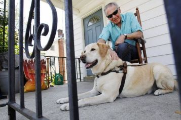 "David Meltz, who is both legally blind and hearing impaired, is seen with his guide dog, ""Hadar,"" at his home in Washington. Meltz says he qualifies for new hearing aids through the NJ Commission for the Blind and Visually Impaired, and he submitted the paperwork at the start of 2015, but he's still waiting to be approved. (Jerry McCrea/For NJ Advance Media)"