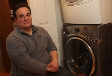 Dave Carbone is frustrated with his brand-new Whirlpool washing machine. It took four visits from technicians to get the machine to work. (Frances Micklow | For NJ Advance Media)